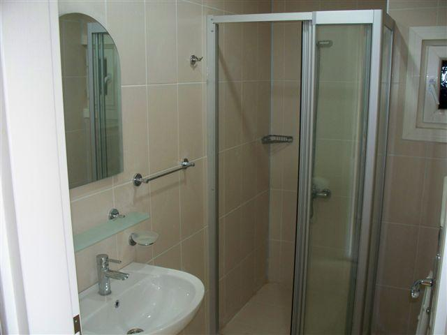 The home has two shower rooms with vanity unit and toilet