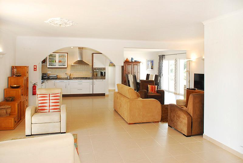 Large lounge with open plan kitchen