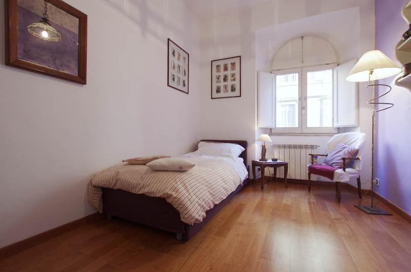 Second bedroom  with single bed arrangement