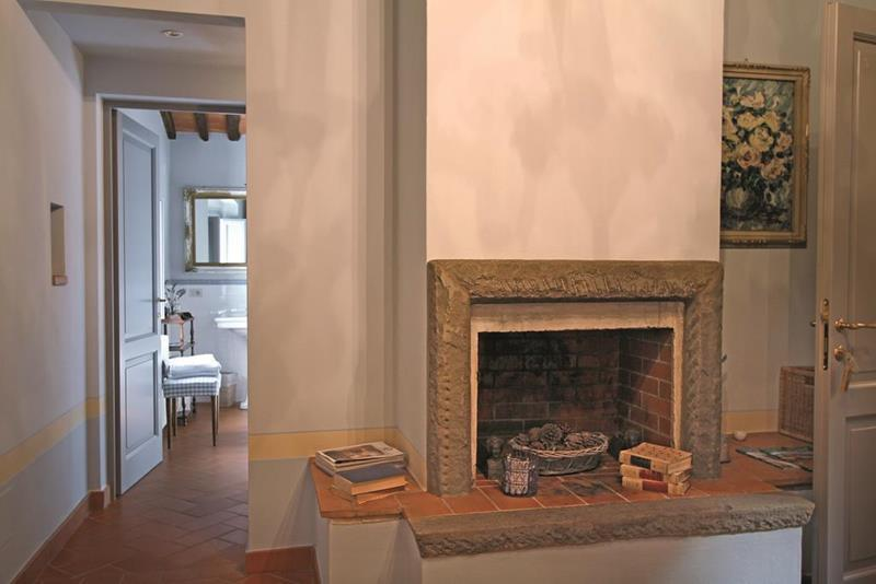 The bedroom with fireplace