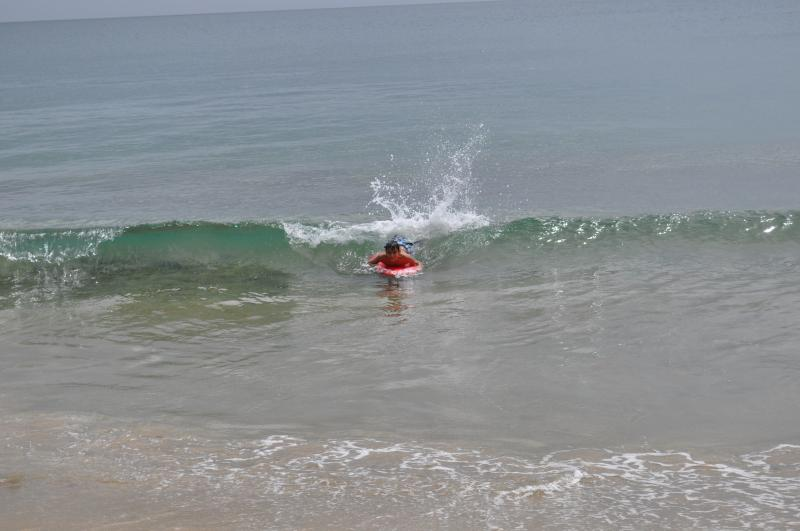 Boogie boarding at the beach.