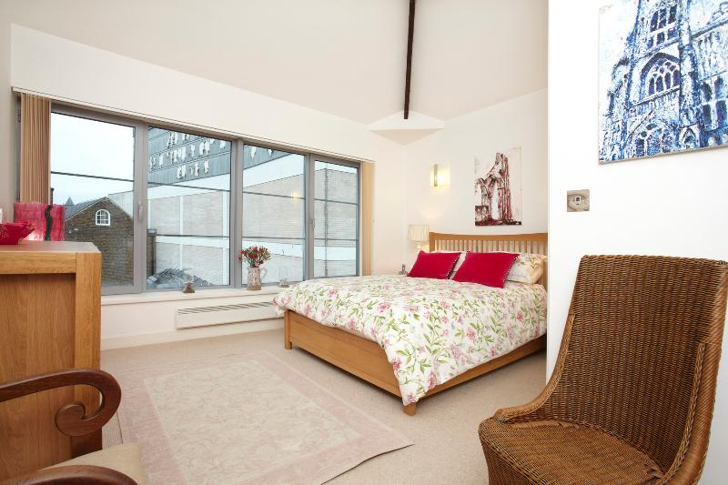 Master bedroom - elegant and bright with far reaching views of York's skyline. Generous storage