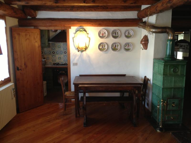 Dining area (seats 8. Extension available for 2 extra seats). Stove fed by firewood