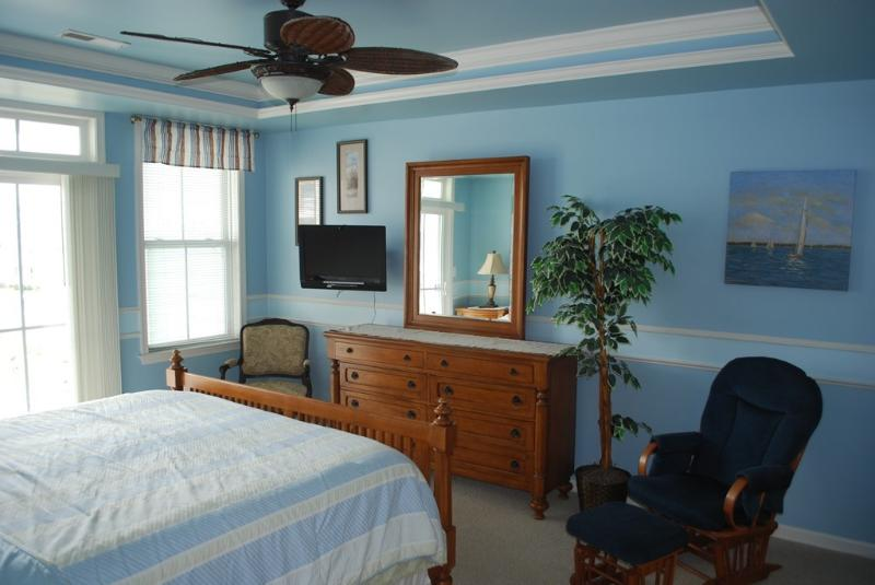 Master Bedroom with Bamboo Ceiling Fan and Wall Mounted LCD TV & DVD player