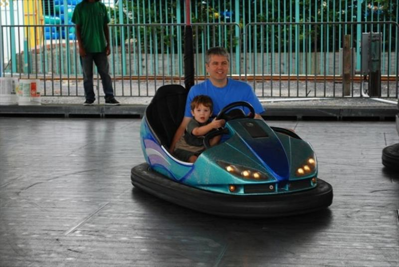 Daddy got roped into riding bumper car with son at Jolly Rodger's.