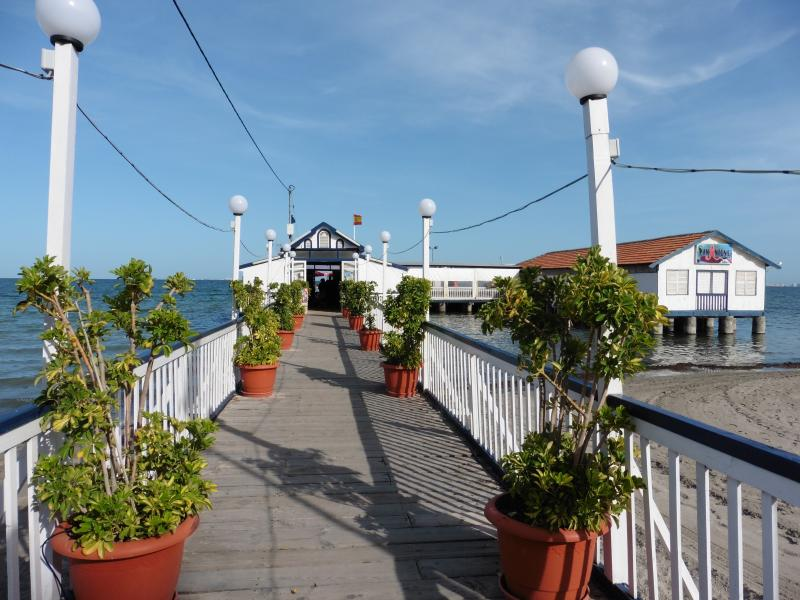 15 mins walk San Antonio fabulous restaurant  bar short stroll along the pier overlooking the fish!!