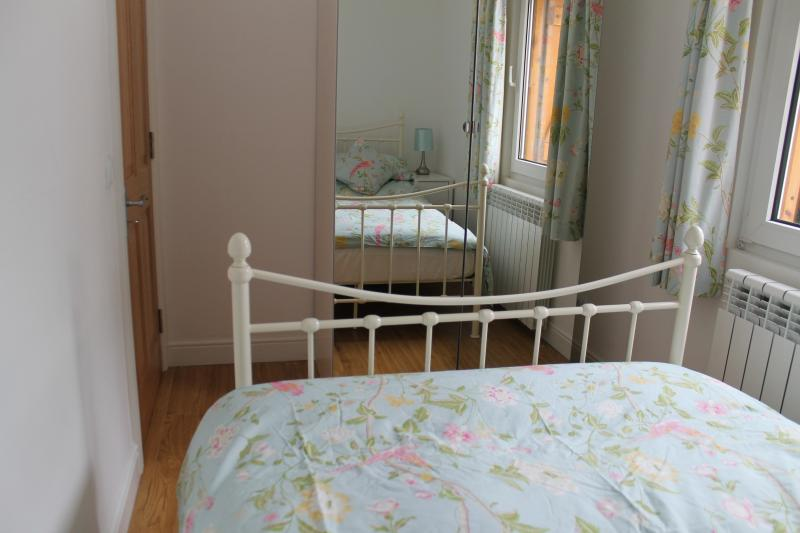Bedroom 3. Double bed, large mirrored wardrobe.