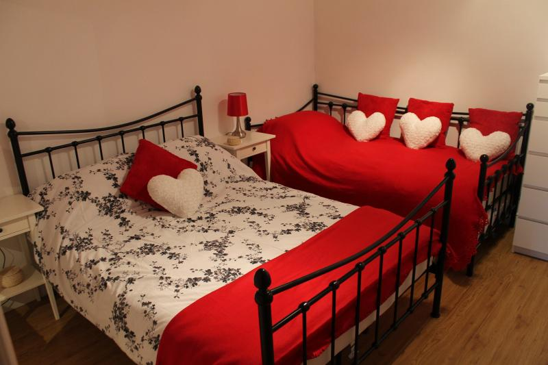 Bedroom 1. Double bed and single bed. Fitted wardrobe with mirror, chest of drawers.