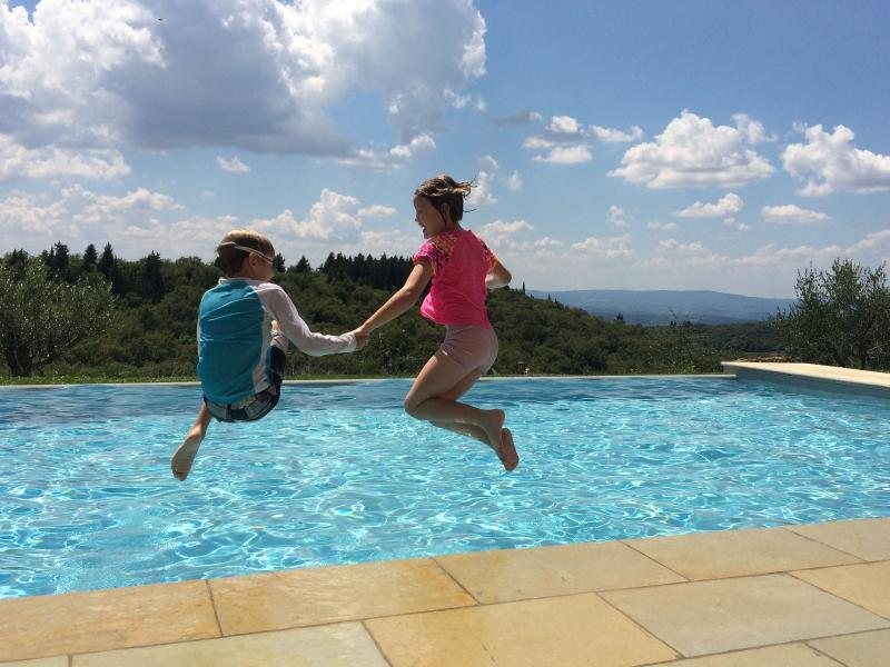 Jumping into the swimmingpool with the view of the Tuscan hills: what else?