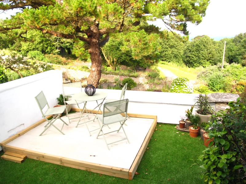 our terrace at Little Oasis, space to eat and relax, sun loungers provided also parasol!
