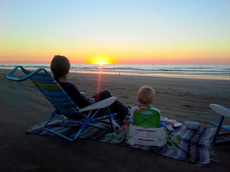 Sunrise breakfast on the beach.  Full disclosure... that's my wife and son!