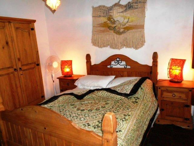 Main bed, has wardrobe, chest of drawers and side cupboards