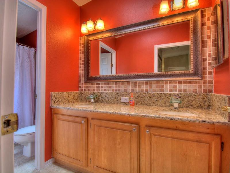 Guest Bathroom with double sinks, tub/shower combination