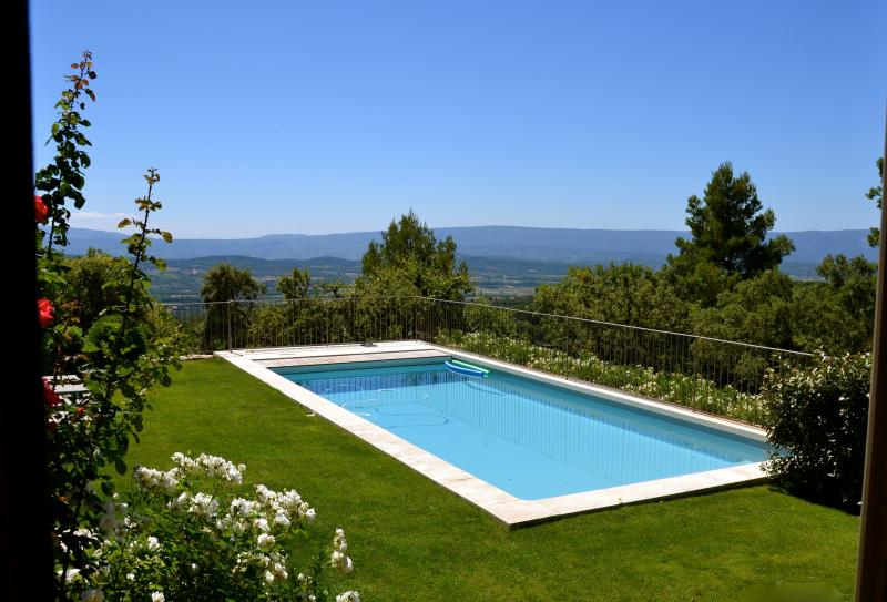 Pool view with flowers - trees have been cut in the meantime