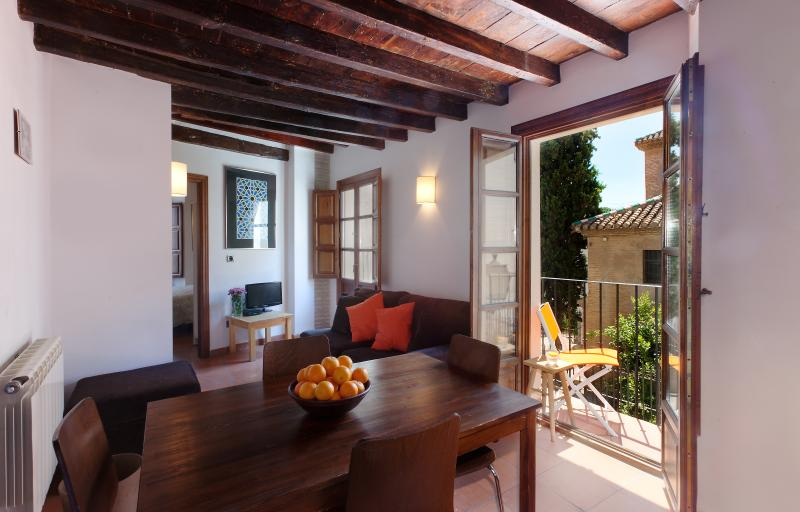 bright living room with small south facing balcony over looking quiet square