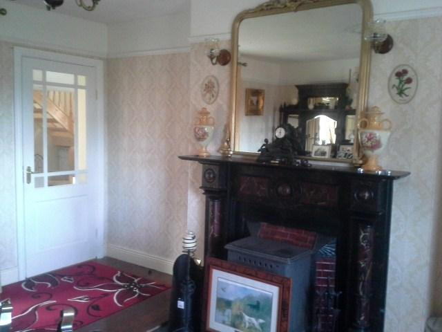 Beautiful old fireplace with solid fuel stove