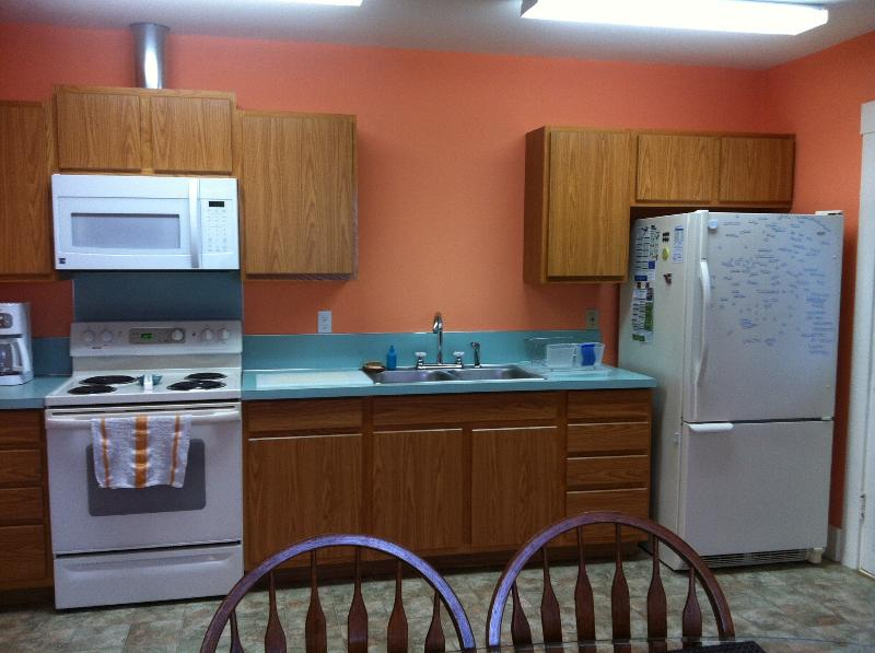 Full sized fridge, stove, oven, microwave, coffee maker and double sink in the kitchen