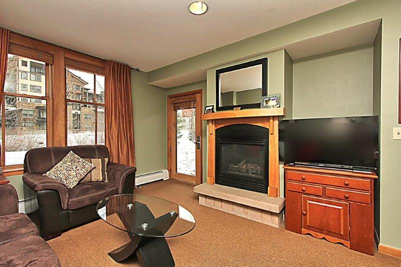 Enjoy a movie on the flat screen TV or cozy up to the gas fireplace