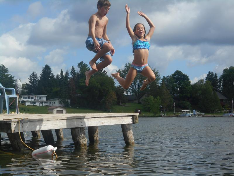 Jumping off the dock- summer memories to last a lifetime!