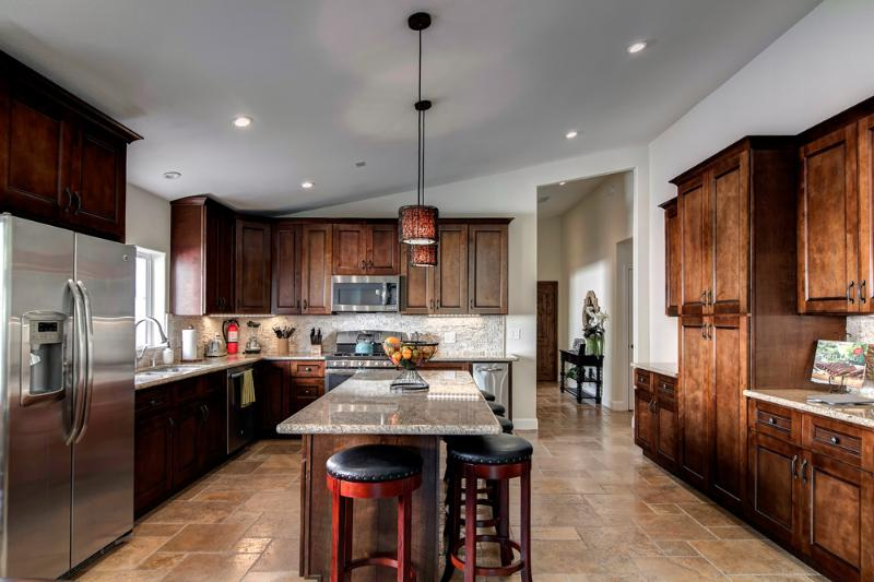 Gourmet Kitchen- Stunning collaboration of stainless, stone and hardwood