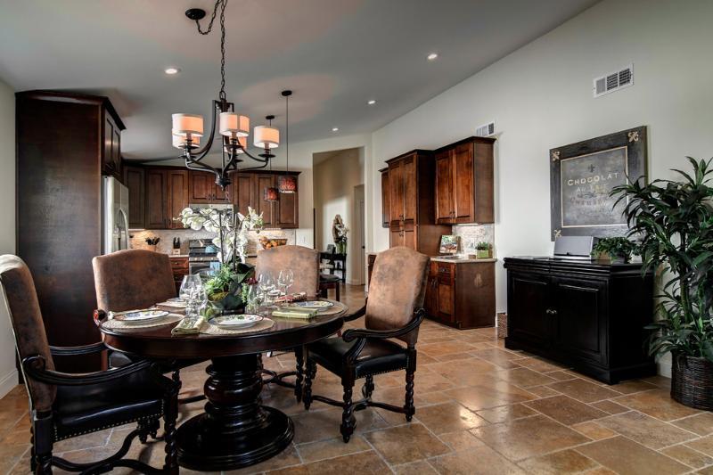 Dining- Beautiful custom table and seating. Tasteful settings, stem and flatware