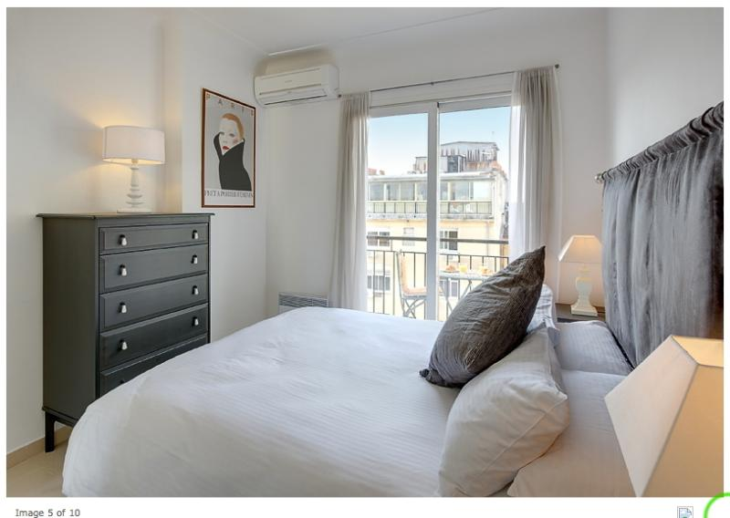 Main bedroom. Air-conditioned with king-size double bed. Access to balcony. Large wardrobe.