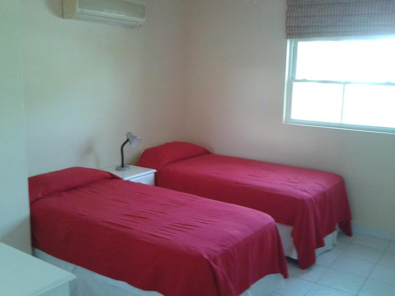 twin bed room with built in wardrobes and aircon.
