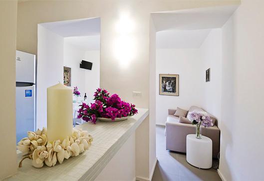 ingresso soggiorno - cucina con divano letto