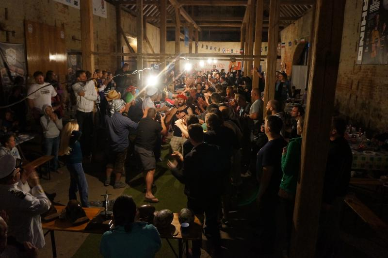 about 200 people having fun in one of the Big Barns