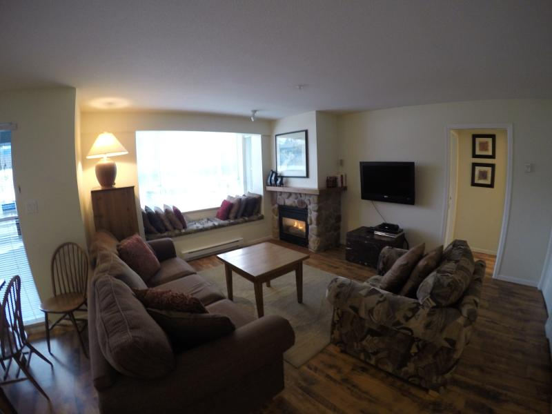livingroom overlooking whistler blackcomb with gas fireplace and flat screen TV