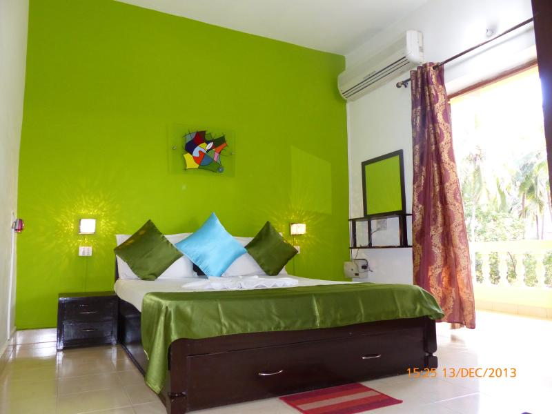 The Bright green bedroom. Beautiful, comfortable, sunny and airy.