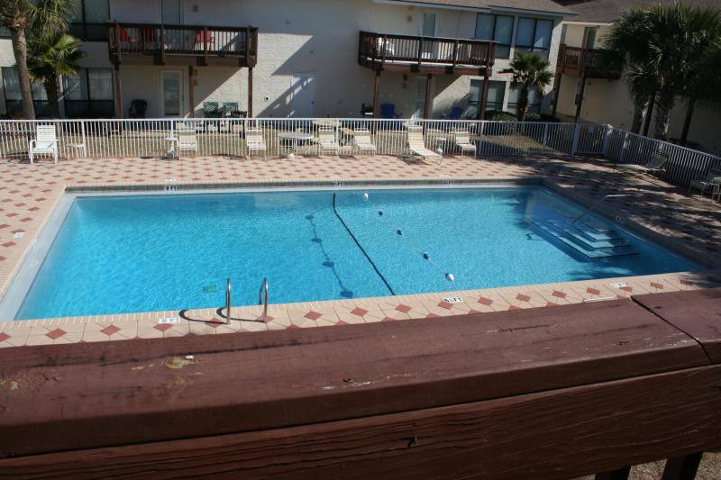 Your view of the large community pool from the condo balcony