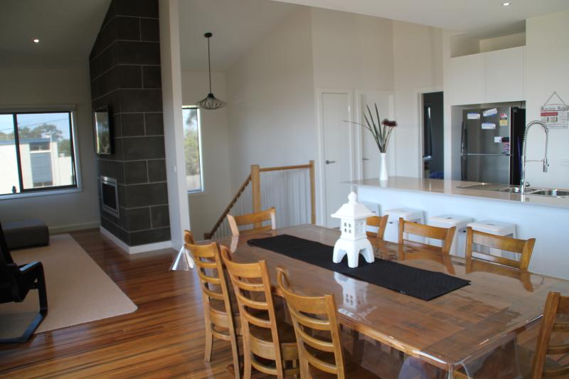 Indoor dining with well stocked gourmet kitchen and butlers pantry