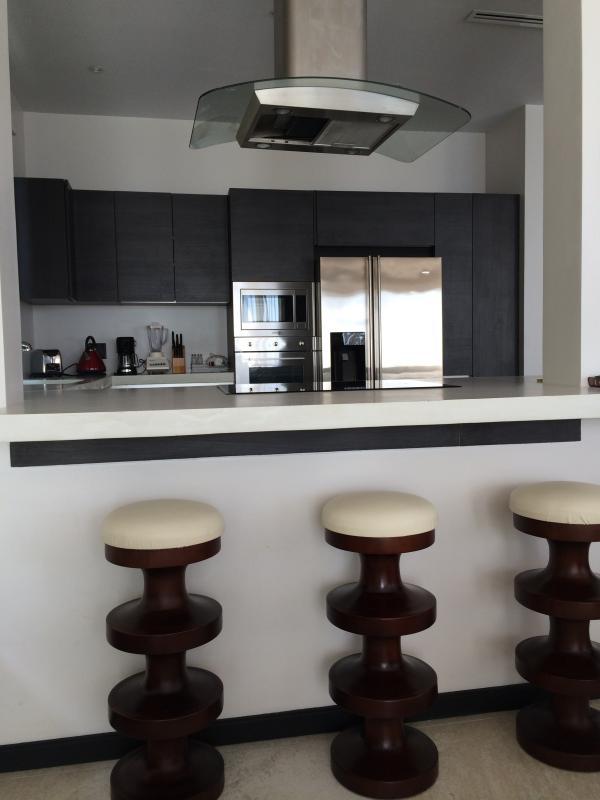 Breakfast bar leading to kitchen
