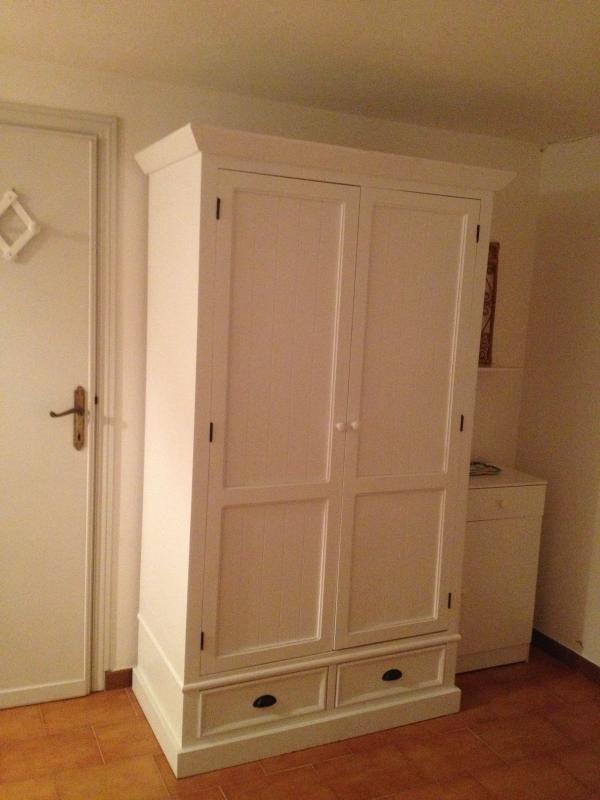 Downstrais bedroom cupboard - door leading to garage
