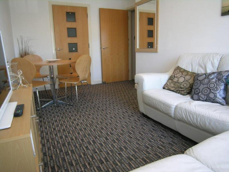Large comfy leather sofa in lounge with flat screen TV & i pod dock, perfect for chilling out.