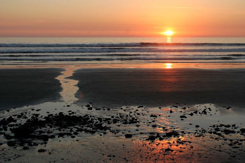 Enjoy gorgeous sunsets on the Strand.
