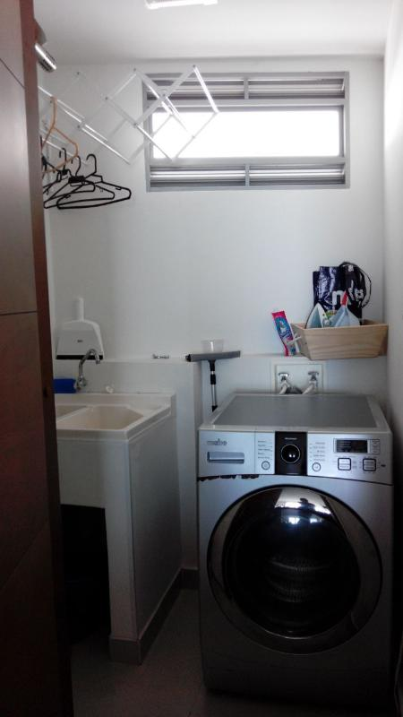 The laundry room with a combo washer/dryer