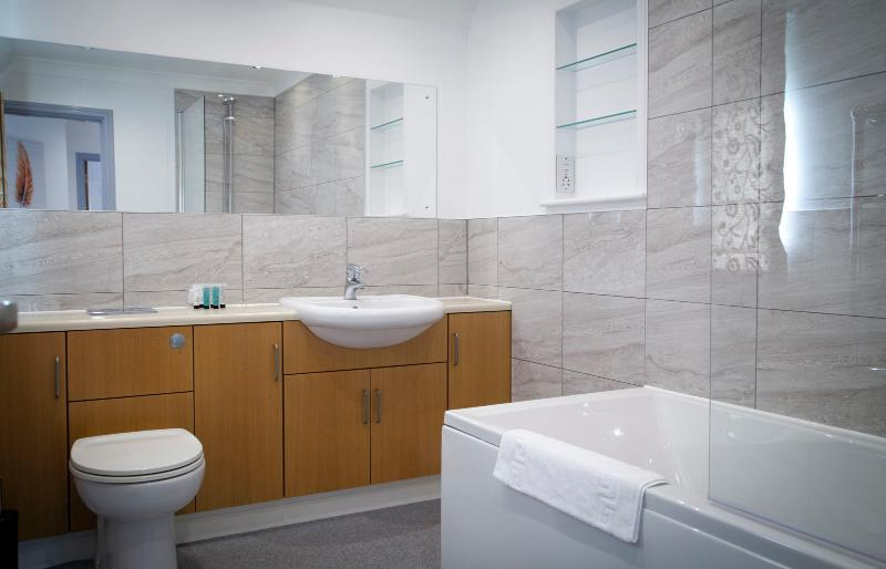 Spacious family bathroom with bath and shower.