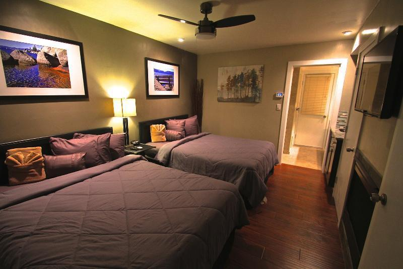 Studio with two queen beds, smaller kitchenette and full bath.