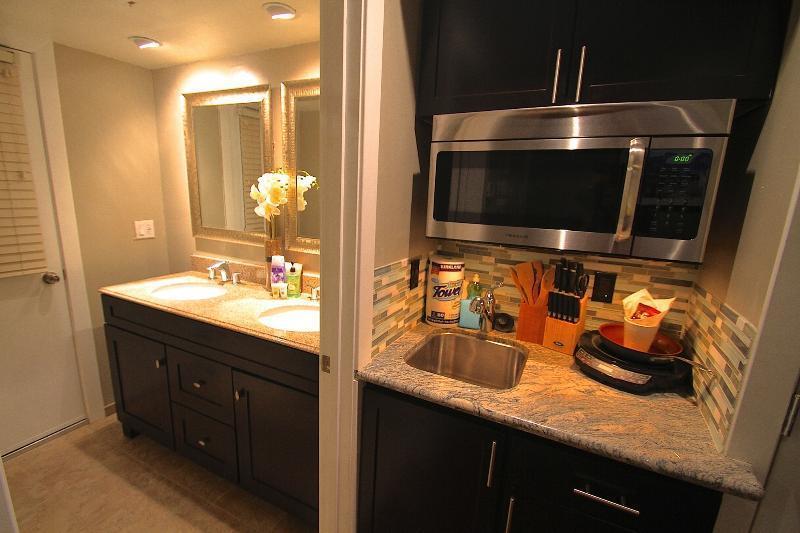 Smaller kitchenette in studio with 2 queen beds.