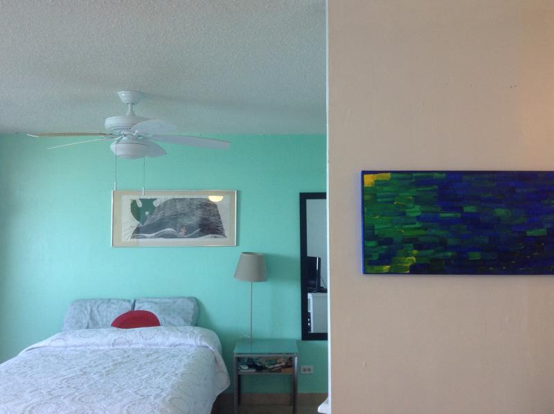 Comfortable queen size bed and original artwork
