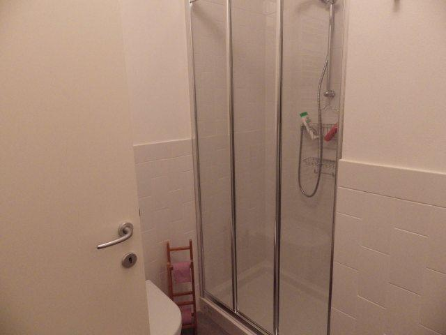 The shower in the second bathroom