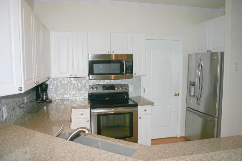 Upgraded granite counter tops with beautiful backsplash and s.s. appliances.