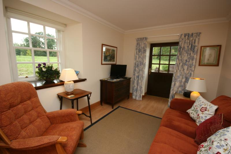 Living room with patio door and window facing the parkland