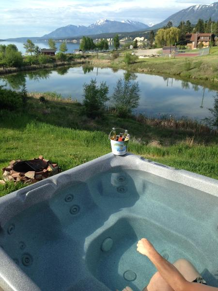 Private hot tub with a great view of the beach.  Kids can play while you watch.