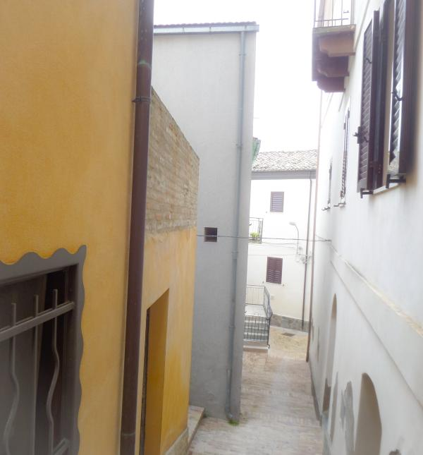Mediaeval alleyway leading from the church to the house (the grey one on the left)