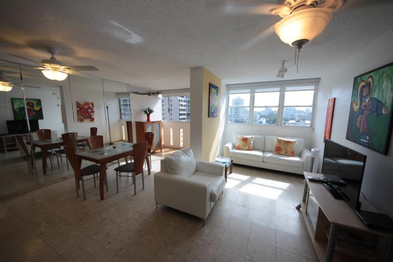 Living room and dining area.  Apartment is very spacious and sunny