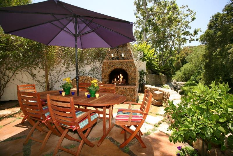 Creekside patio and outdoor fireplace