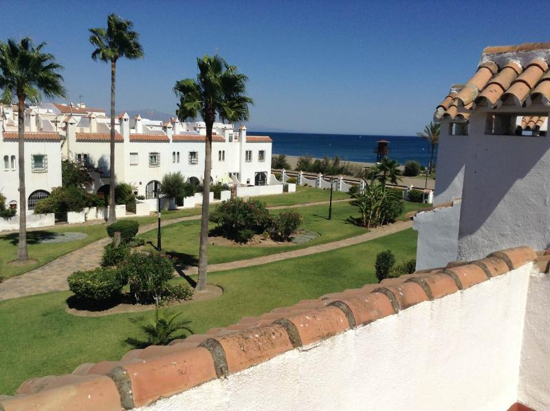 Upper terrace sea & garden views - just a short walk through the gardens directly onto the beach.